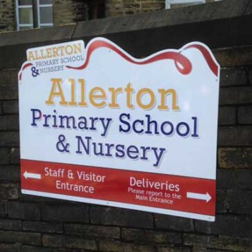school wall directional sign