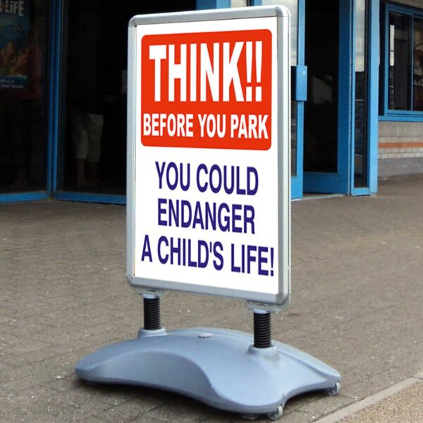 Think before you park safety pavement sign
