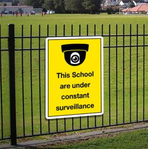 This School Is Under Constant Surveillance Sign alternate image