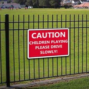 Caution Children Playing Please Drive Slowly alternate image